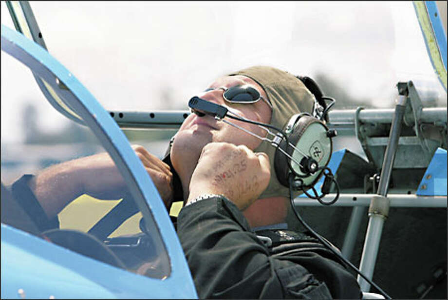 Show performer Jerzy Strzyz gets read to head out in his Sukhoi SU-26. Photo: Meryl Schenker, Seattle Post-Intelligencer / Seattle Post-Intelligencer