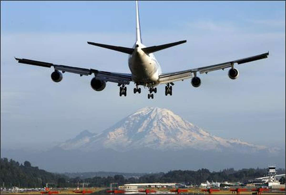 A Boeing 747 comes in to land at Boeing Field. The larger engine, second from the left, is one of the Rolls-Royce Trent 1,000 engines being tested for use on the new Boeing