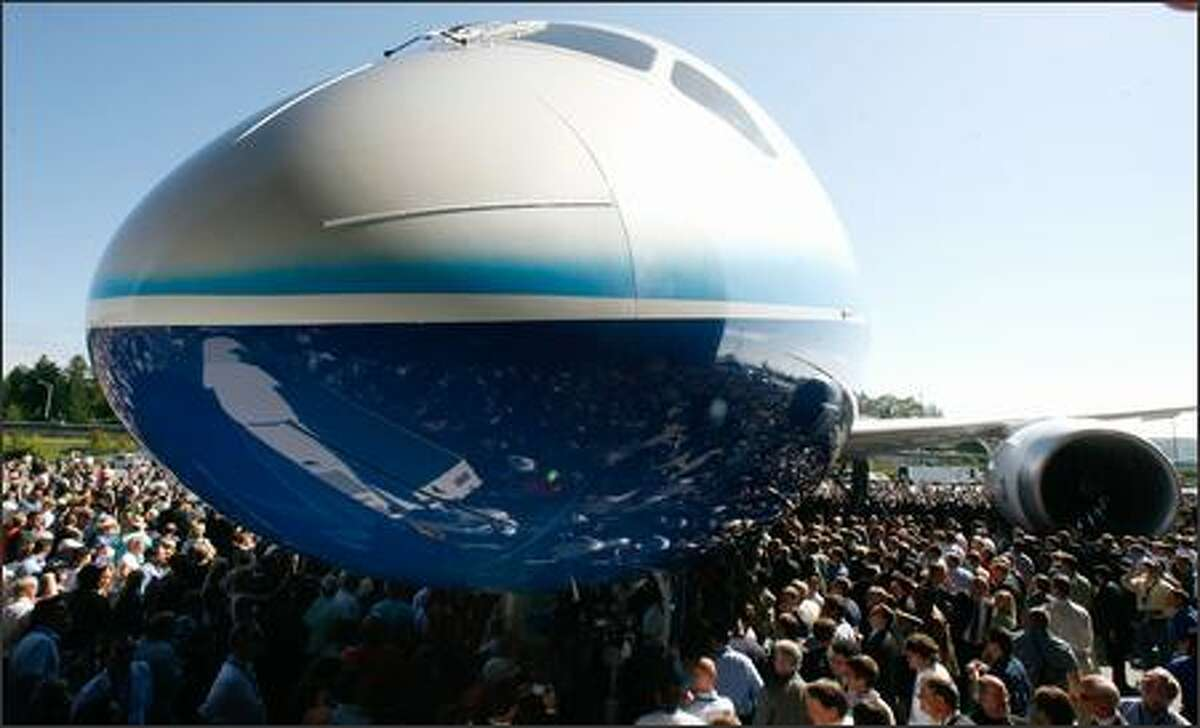 The crowd of 15,000 current and former Boeing employees gets a close-up look at the first completed Boeing 787 Dreamliner.