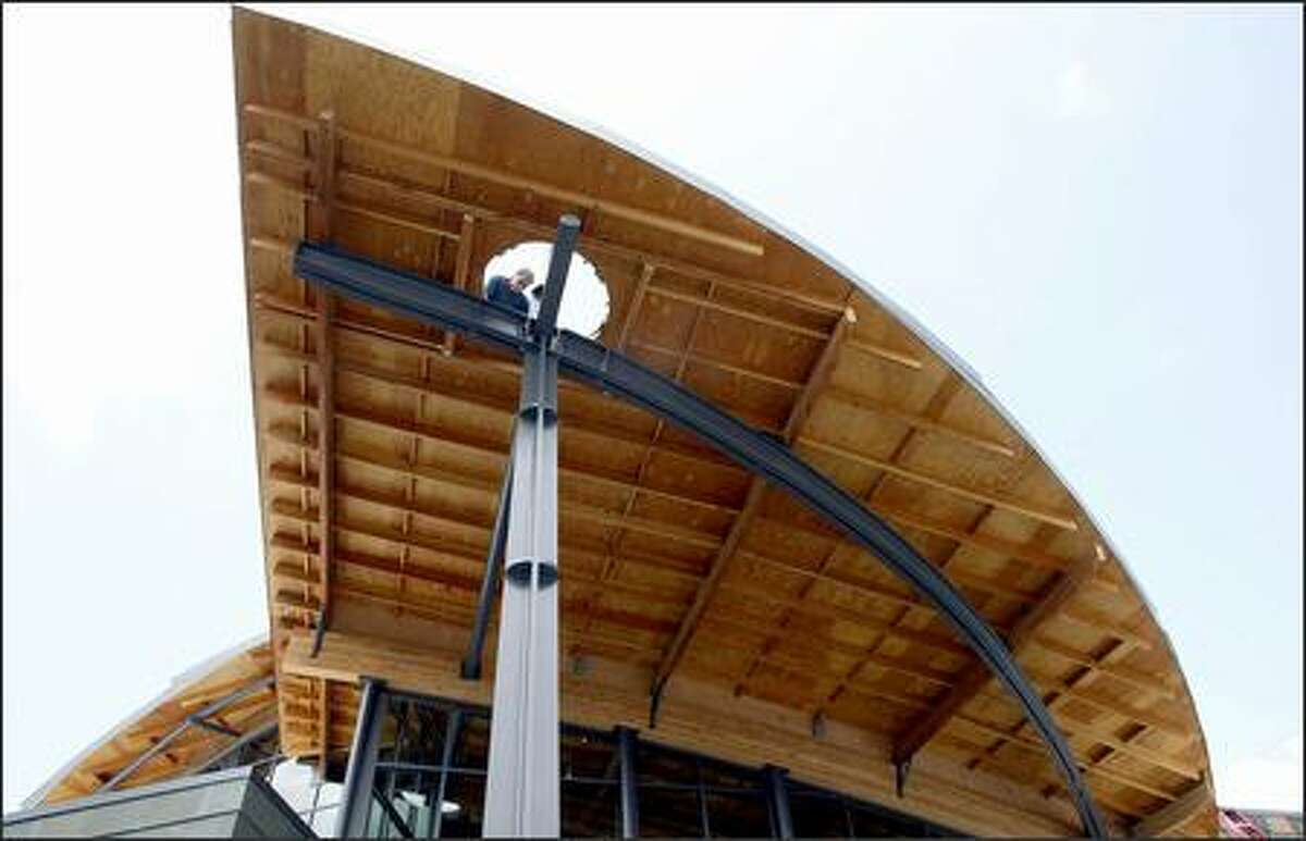 Peter Schomaker, Steele Corp.'s project superintendent for the Beacon Hill Library, applies finishing touches.
