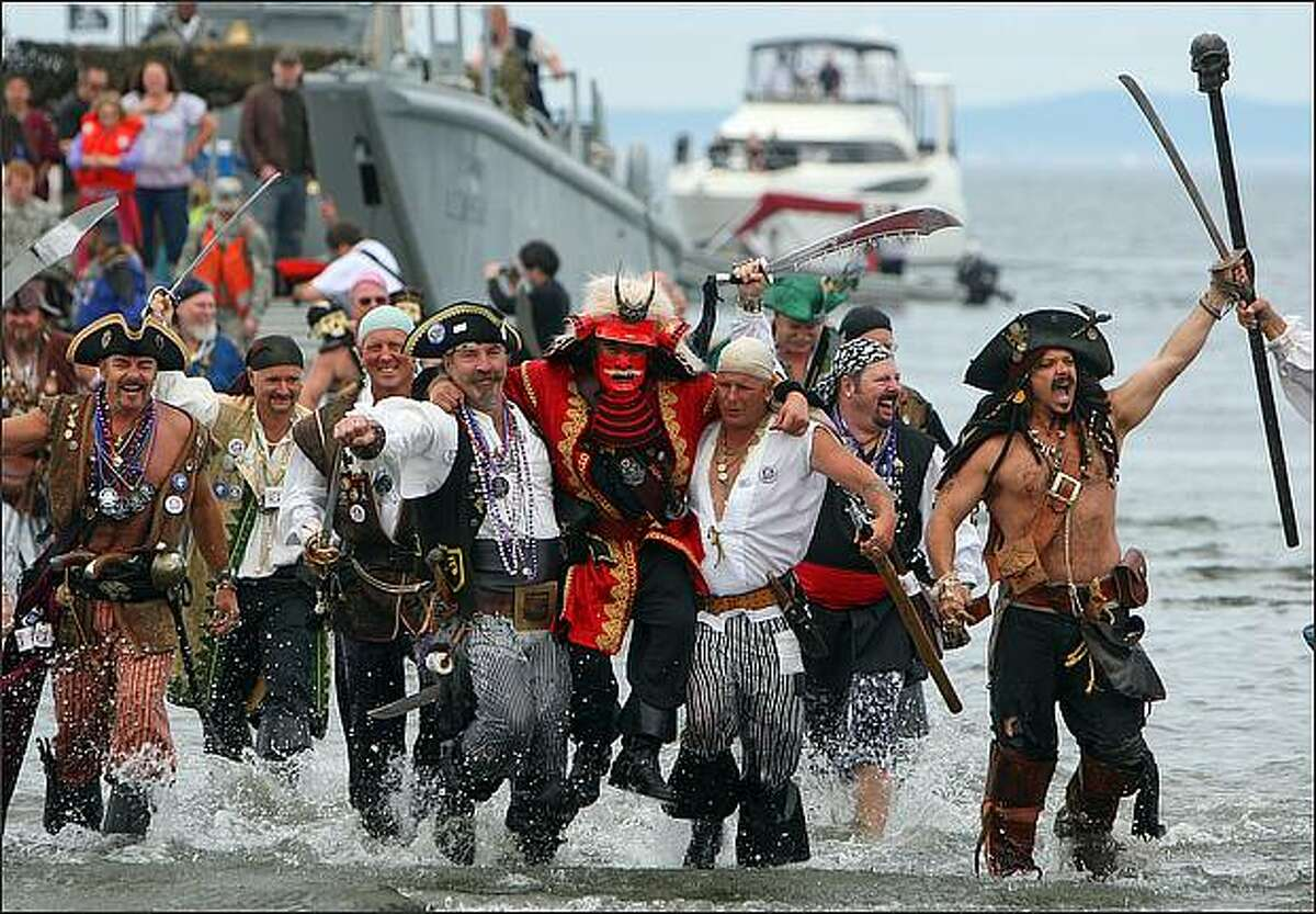 The rowdy Seafair Pirates storm Alki Beach in West Seattle to mark the beginning of Seafair.