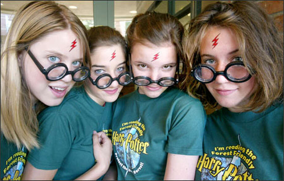 "Harry Potter fans (left to right) Grace Pufert, 14; Celia Buckingham, 14; Stephanie Willis, 14; and Abby Callahan, 13, sport lightning-bolt tattoos and thick glasses during a party Tuesday at Cafe Appassionato on Queen Anne in honor of the release of ""Harry Potter and the Half-Blood Prince."" The event also promoted calls for a U.S. recycled-paper edition of the latest book in the series. Photo: Grant M. Haller, Seattle Post-Intelligencer / Seattle Post-Intelligencer"