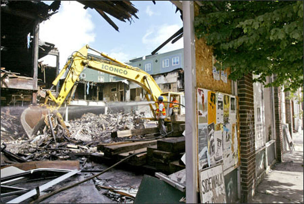 The former site of the Speakeasy Cafe in Belltown, which burned down in a fire four years ago, is being demolished to make way for new residential development.