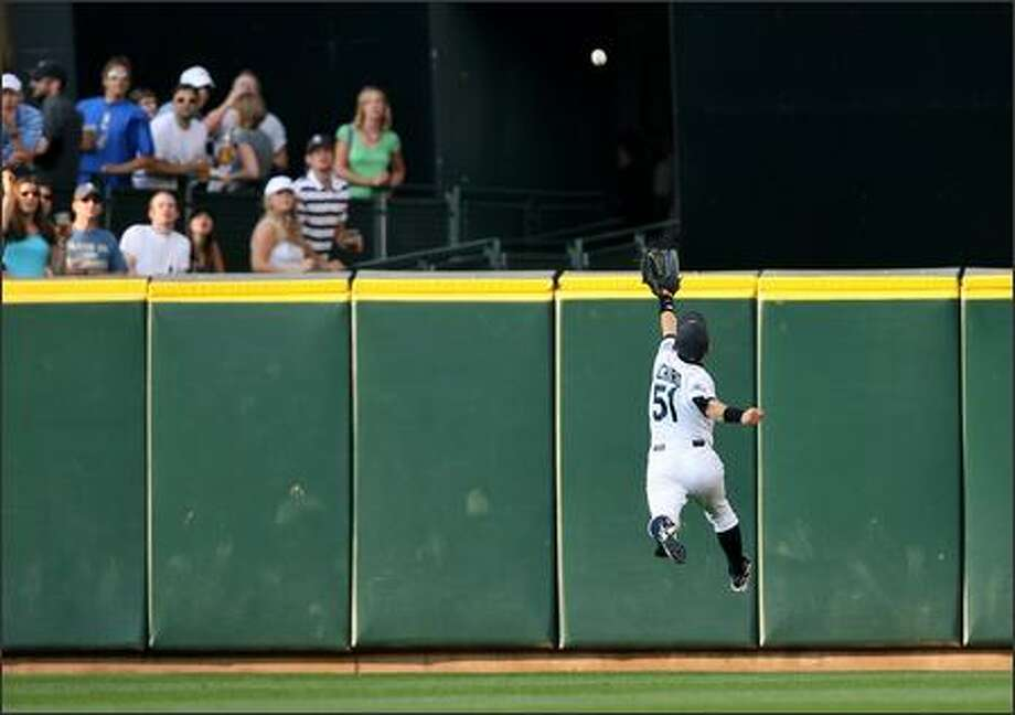 Ichiro Suzuki leaps in vain for a line drive by Curtis Granderson in the third inning. Granderson turned the hit into a double. Photo: Mike Urban, Seattle Post-Intelligencer / Seattle Post-Intelligencer