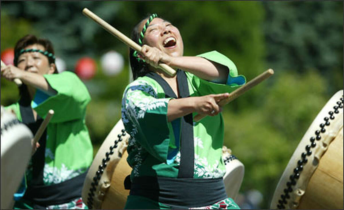 Northwest Taiko drummers Nancy Kuan, left, and Akada Sakata perform at the Seattle Buddhist Temple on Main Street at Bon Odori, a festival celebrating Japanese and Buddhist traditions of honoring one's ancestors.