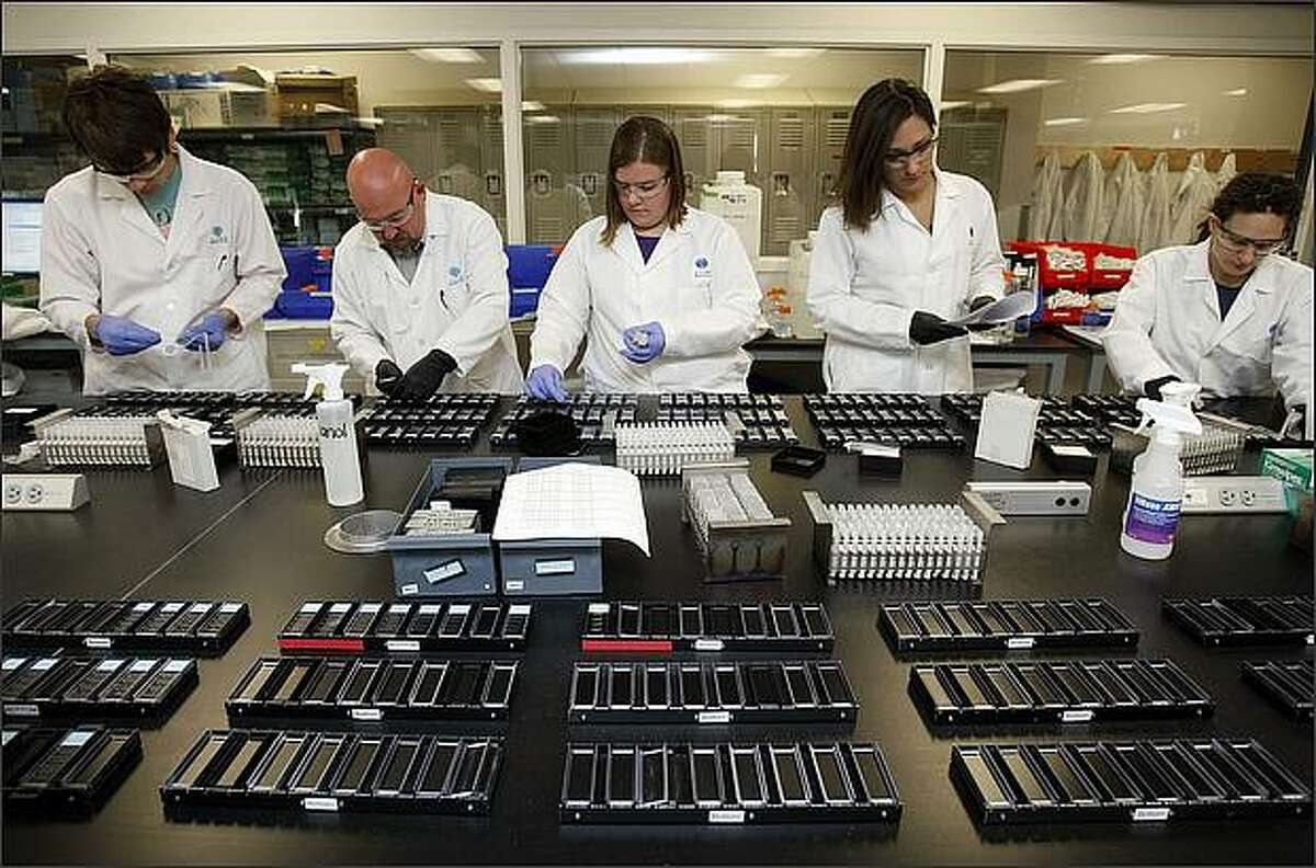 (l-r)Josh Lindgren, Andreas Alpisa, Krissy Brouner, Sheana Parry and Jody Parente work in the main production lab at the Allen Institute for Brain Science in Seattle.