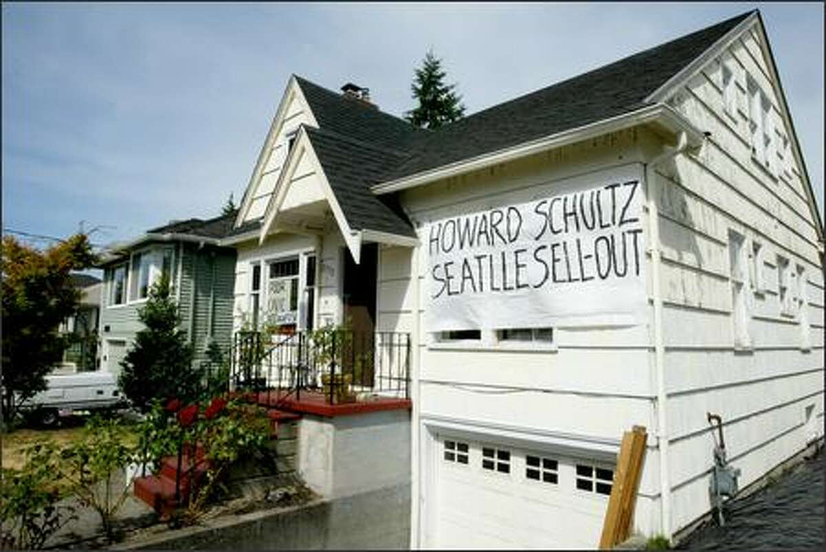 A banner on a house in the 2300 block of Southwest 50th Street expresses one West Seattleite's view of the sale of the Sonics and Storm to an Oklahoma City group.
