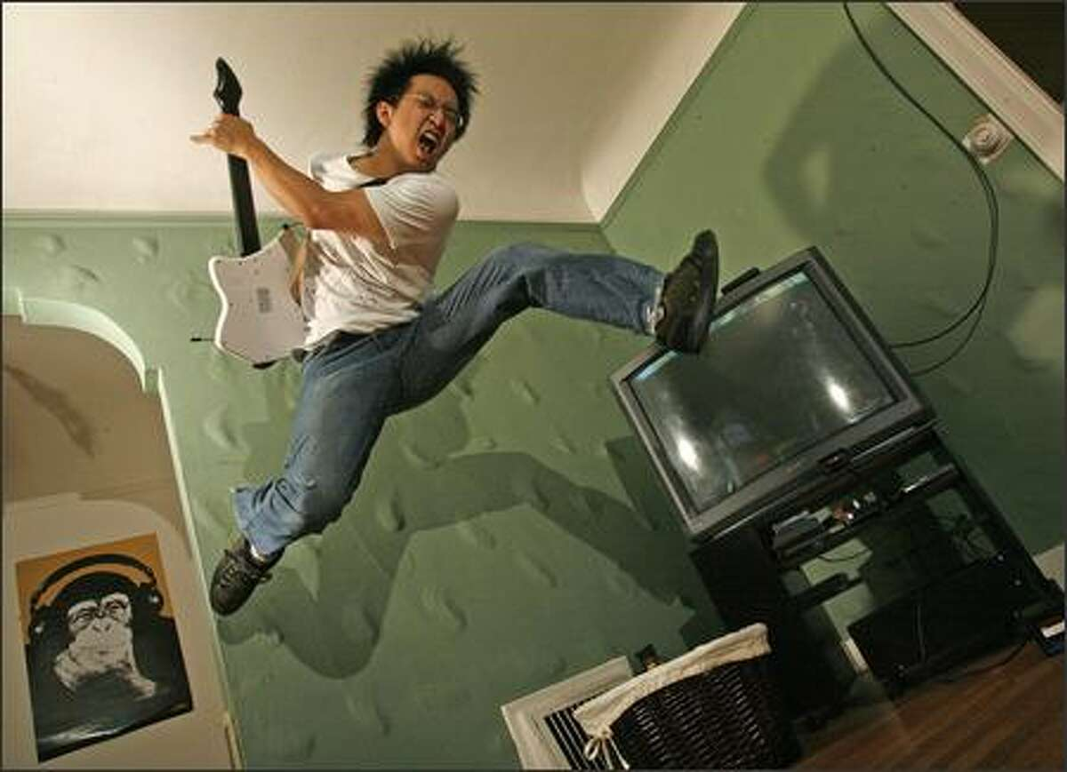 """Freddie Wong doesn't just play the video game """"Guitar Hero,"""" he performs it, which might have helped him win the World Series of Video Games this month in Dallas."""