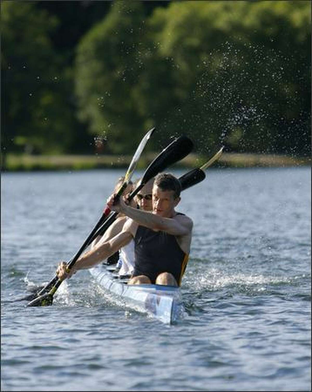 Peter Turcan leads a Seattle Canoe and Kayak Club four-person kayak masters team during a workout on Green Lake.