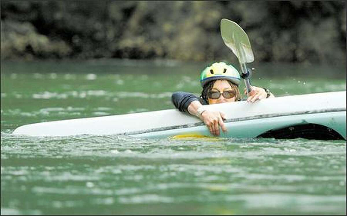 Debra Fiscus of Bellingham is the first to taste saltwater during a recent Whatcom Association of Kayak Enthusiasts class at Deception Pass.