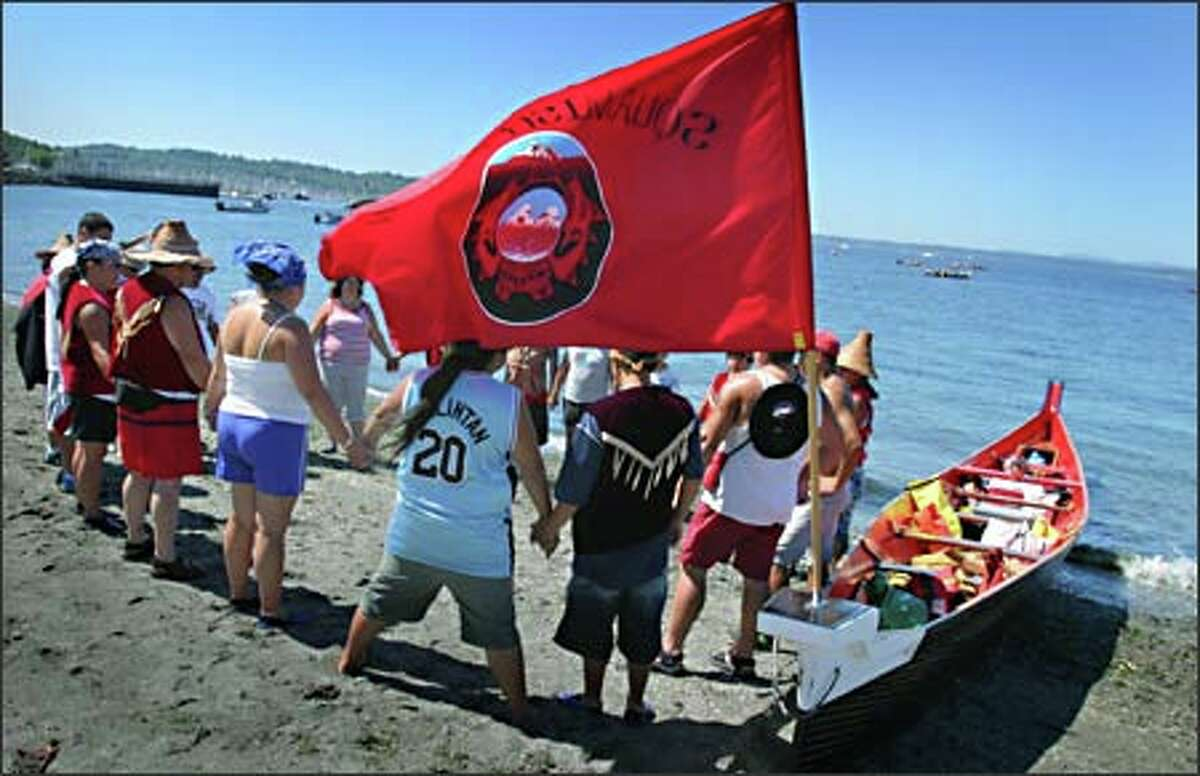 Members of the Squamish Nation pray before they leave Golden Gardens beach. The Canadian Indians were guests Thursday of the Muckleshoot Tribe during