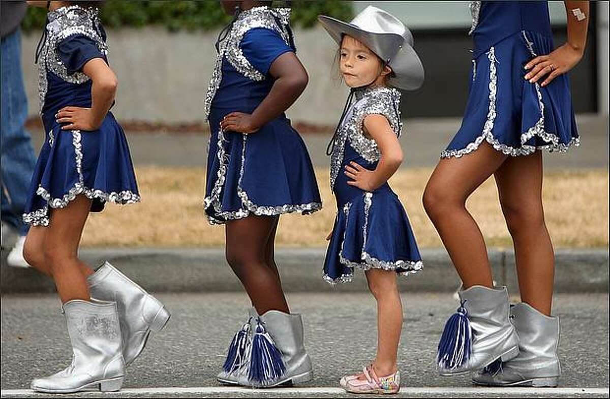 Angel Ferret, 4, from Lakeside, Wash., lines up with fellow members of the Northside Drill Team at the Greenwood Seafair Parade. (Staff Photo/Seattle Post-Intelligencer/Mike Kane)
