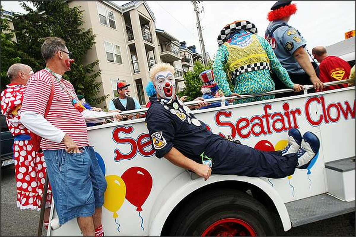 """Jay """"Woody"""" Wood, one of the Seattle Seafair Clowns, gets things rolling at the Greenwood Seafair Parade. (Staff Photo/Seattle Post-Intelligencer/Mike Kane)"""