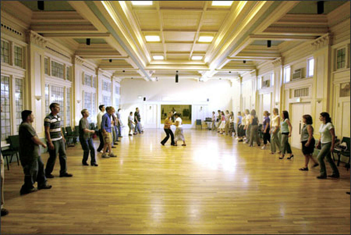 Dance students practice salsa in the Wilsonian Grand Ballroom, on University Way Northeast in the University District, which the building's owner wants to redevelop.
