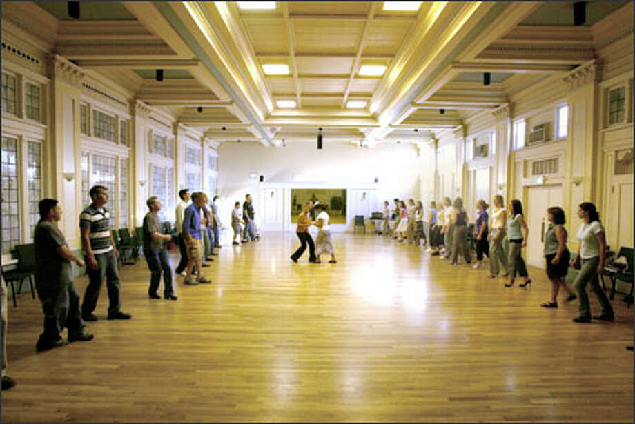 Dance students practice salsa in the Wilsonian Grand Ballroom, on University Way Northeast in the University District, which the building's owner wants to redevelop. Photo: Mike Urban, Seattle Post-Intelligencer / Seattle Post-Intelligencer