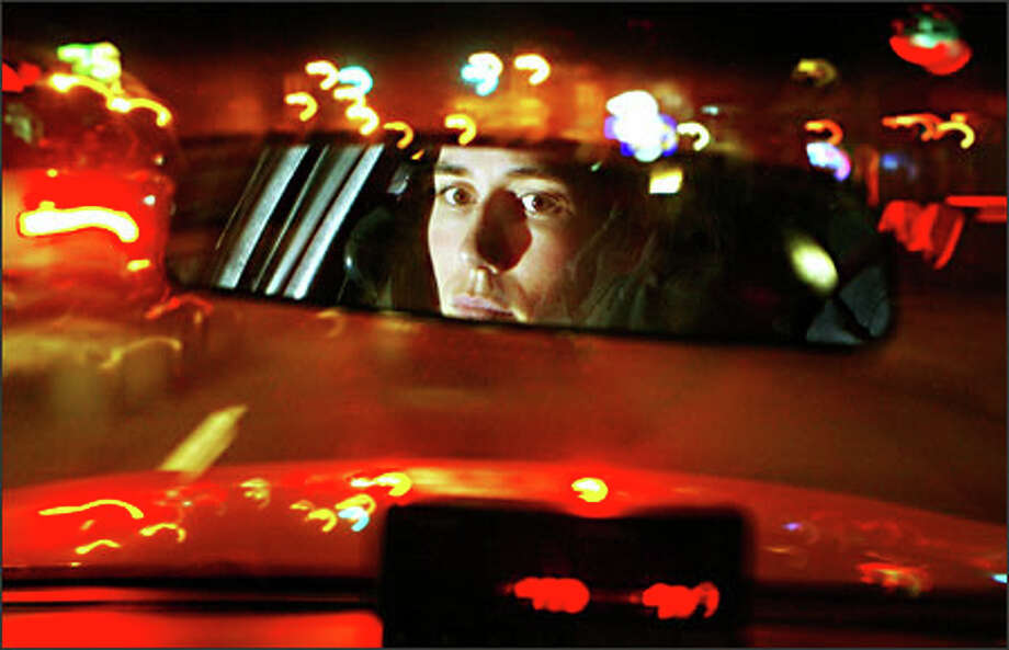 Allison Simonis routinely drives her cab through downtown Seattle at night. Although she has had some close calls with fares, she is leery about putting a camera in her vehicle. Photo: Mike Urban, Seattle Post-Intelligencer / Seattle Post-Intelligencer