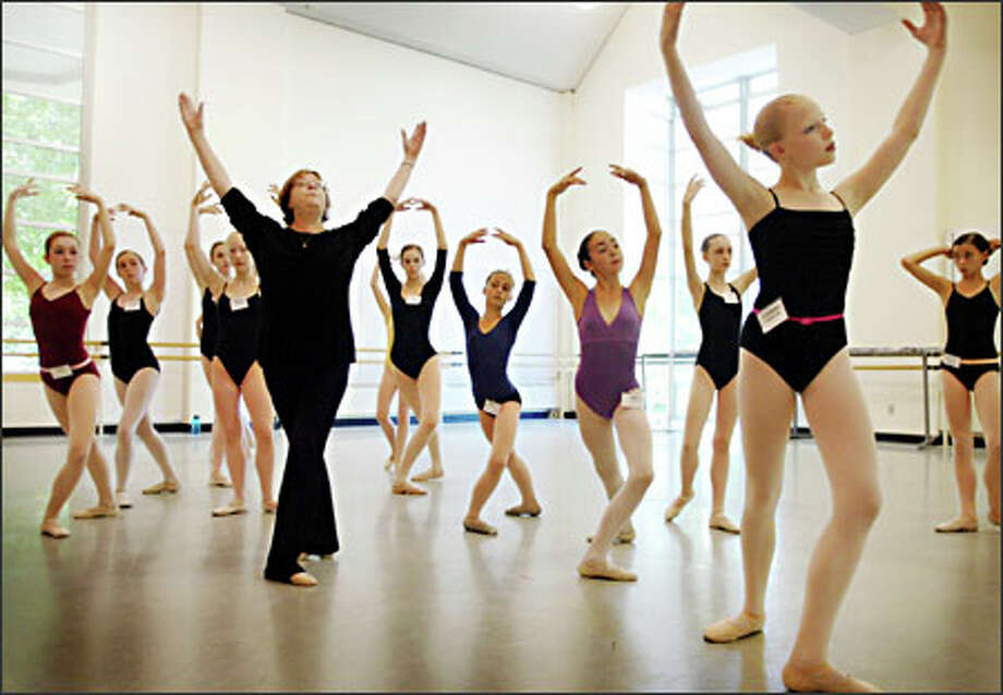 Pacific Northwest Ballet faculty member Victoria Pulkkinen works yesterday with young students, including Christina Blankenship, 12, from Minnesota, right foreground, during PNB's summer course and workshop program at its studios on Mercer Street. Photo: Joshua Trujillo, Seattlepi.com / seattlepi.com