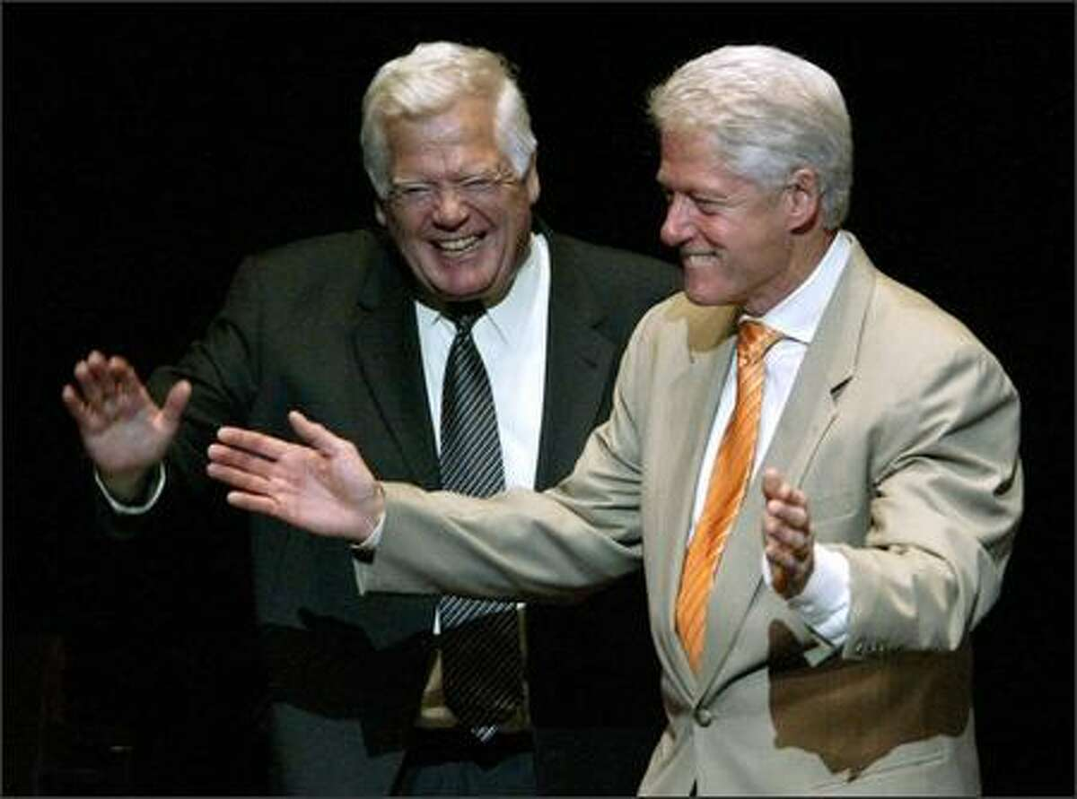 Former President Clinton with Rep. Jim McDermott, D-Wash., at Benaroya Hall on Monday. Clinton spoke at Seattle fundraisers for McDermott and Sen. Maria Cantwell, D-Wash.