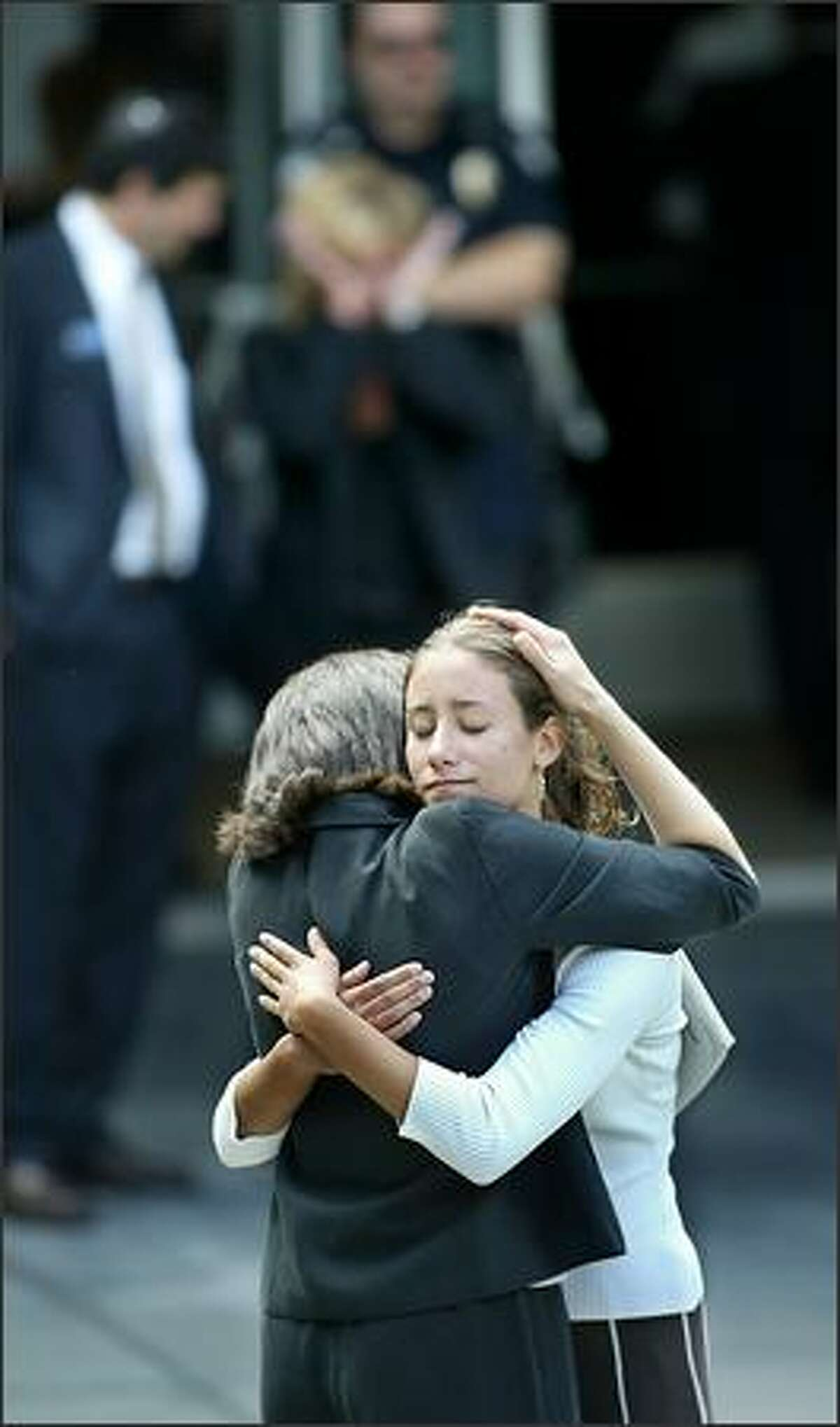 Karen Baer, left, and daughter Rachel Baer embrace Monday before the memorial service for Pam Waechter, at Temple B'nai Torah, in Bellevue. Waechter was killed during a gunman's shooting rampage at the offices of the Jewish Federation of Greater Seattle the previous Friday. The Baers both attend Temple B'nai Torah.