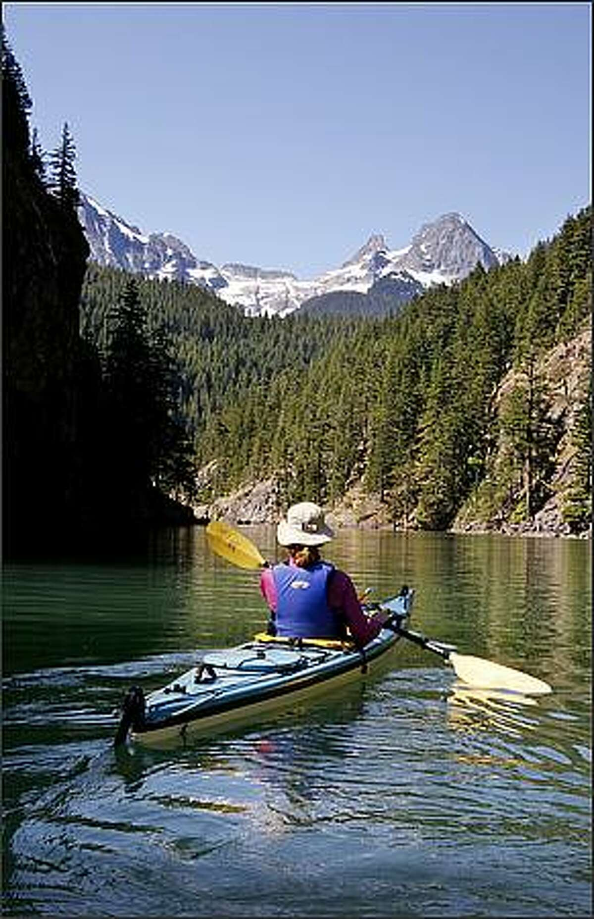 Barbara French paddles on Diablo Lake in North Cascades National Park.