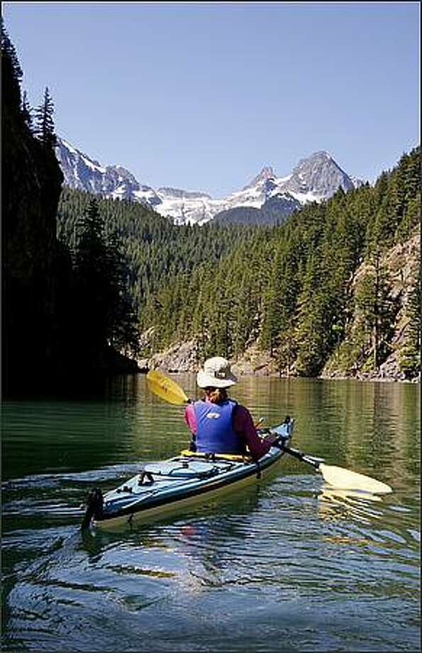 Barbara French paddles on Diablo Lake in North Cascades National Park. Photo: Paul Joseph Brown, Seattle Post-Intelligencer / Seattle Post-Intelligencer