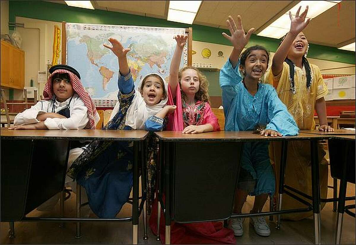 Siraj Hamade, Raya Hamade, Leila Jamal, Marwa Al-Ansi, and Jenin Farajallan participate in an Arabic class run by A.C.E., Associates in Cultural Exchange at Northgate Elementary School. The class is taught by Ahmad Mustapha.