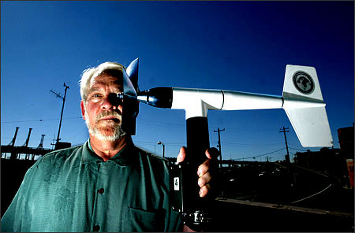 Don Munro, chief executive of Coastal Environmental Systems, displays a wind monitor, part of the company's air traffic control weather system that NASA is using at the shuttle landing facility. The Seattle-based company says it's the nation's largest weather systems provider.
