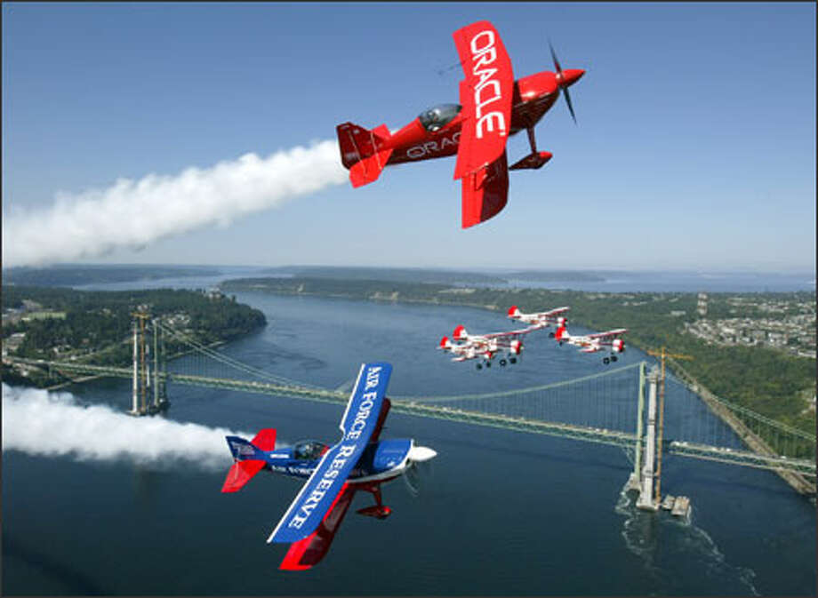 Sean Tucker with Team Oracle, Ed Hamill with the Air Force Reserve Aerobatics Show and the Red Baron Squadron fly over the Tacoma Narrows Bridge. Photo: Mike Urban, Seattle Post-Intelligencer / Seattle Post-Intelligencer