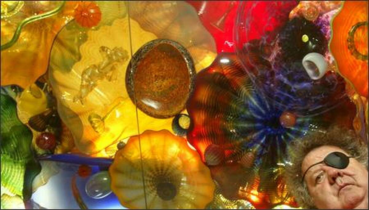 Dale Chihuly stands below a glass ceiling made up of hundreds of his pieces at his Lake Union home and studio. The artist told the P-I this week that he had settled a lawsuit and countersuit with former protégé Bryan Rubino. However, the announcement turned out to be premature.