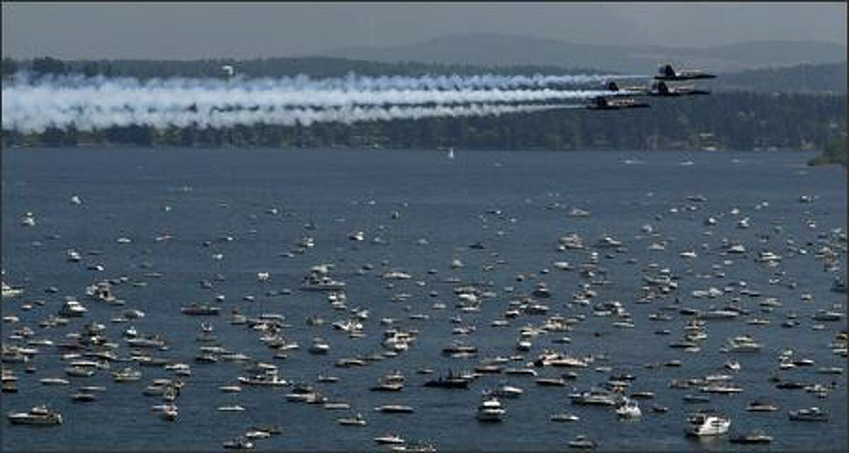 The Blue Angels buzz the boats over Lake Washington in a view from Madrona in Seattle.