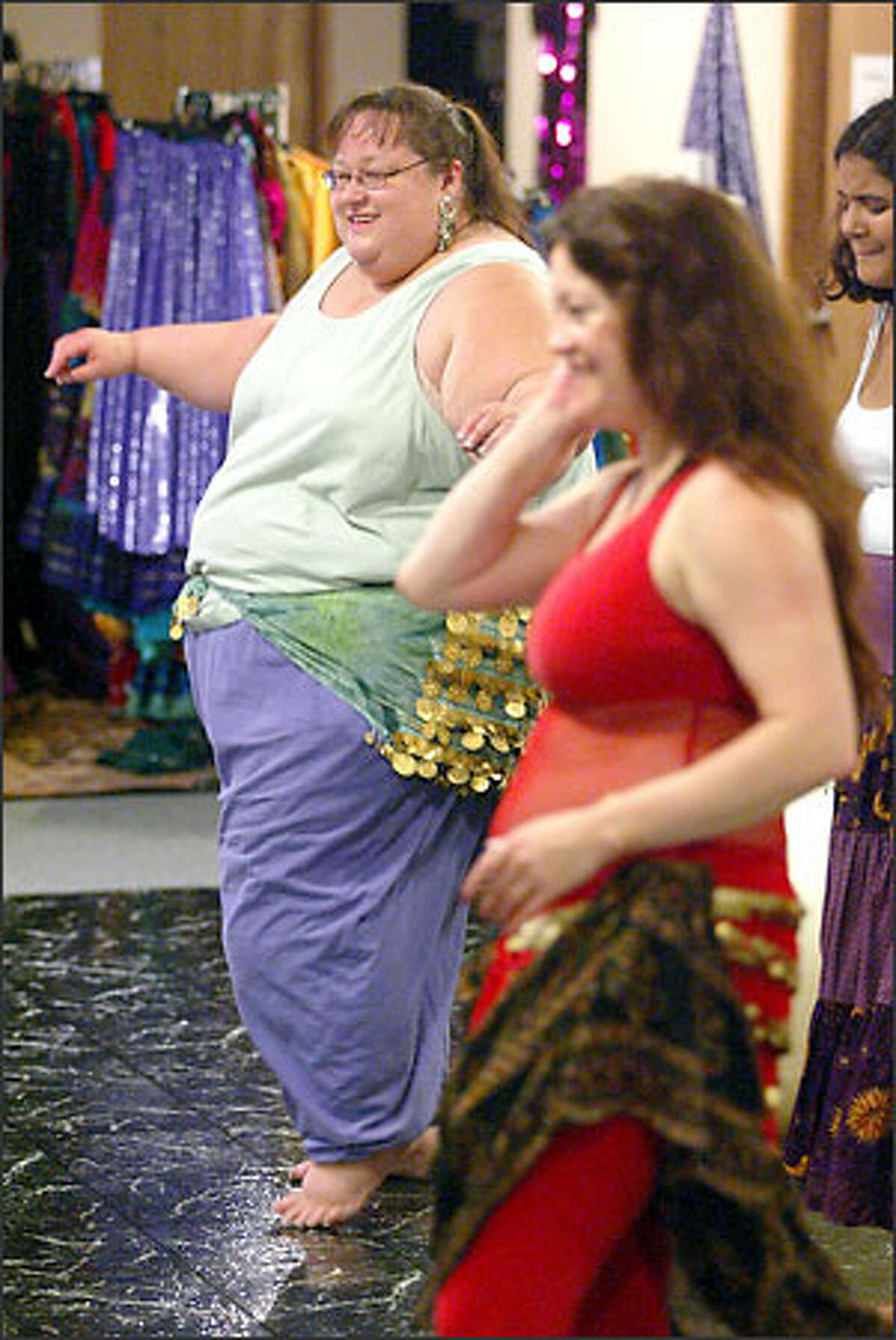 Marty Hale-Evans participates in an intermediate belly-dancing class with instructor Saqra in Kent. Hale-Evans is the founder of SeaFATtle, a group that leads local scale-smashing protests every year in honor of International No-Diet Day.