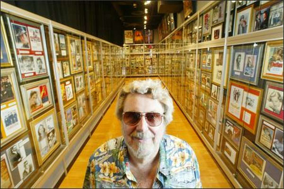 Some the hundreds of autographed photos he's collected surround Mark Mitchell, top, at his Club Hollywood casino in Shoreline. Old Hollywood legends, such as Judy Garland and Marilyn Monroe, are well represented and among the highest valued.