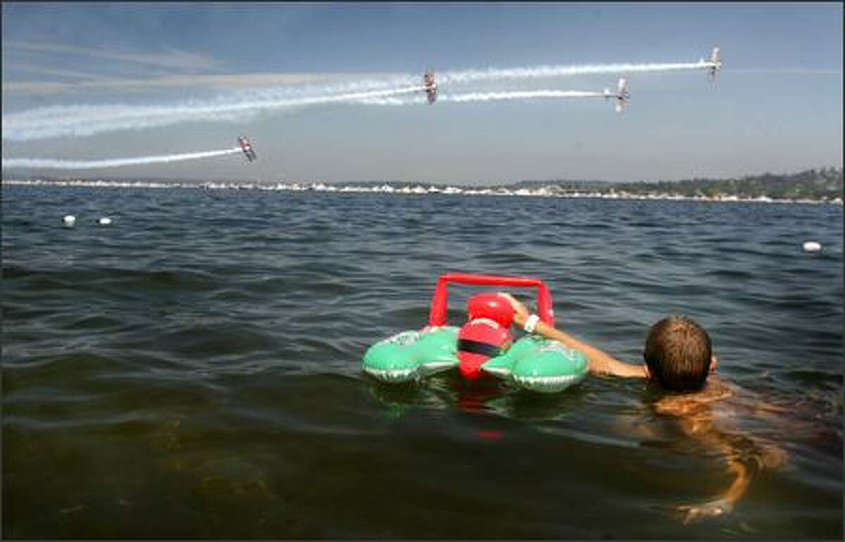 Cody Sellmann watches the Red Baron Pizza Squadron perform over Lake Washington.