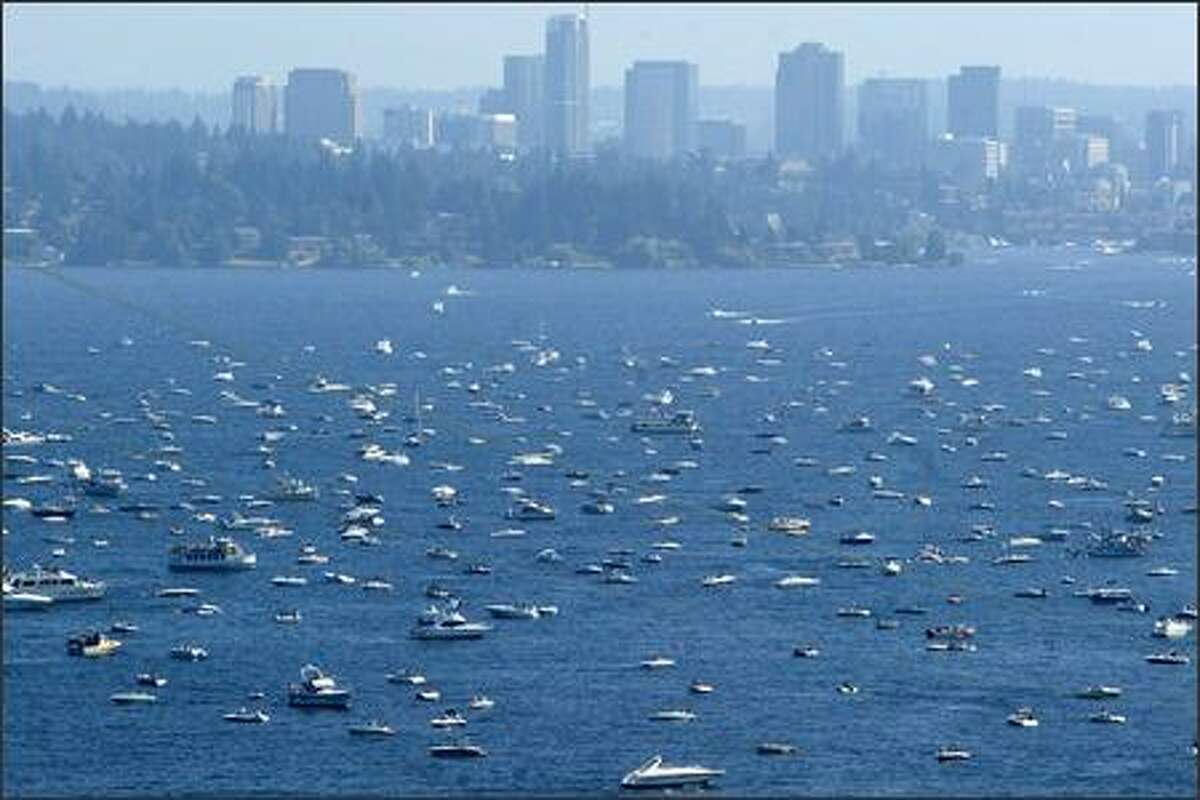 Downtown Bellevue is seen behind thousands of boats bobbing on Lake Washington during the Blue Angeles show on Sunday.