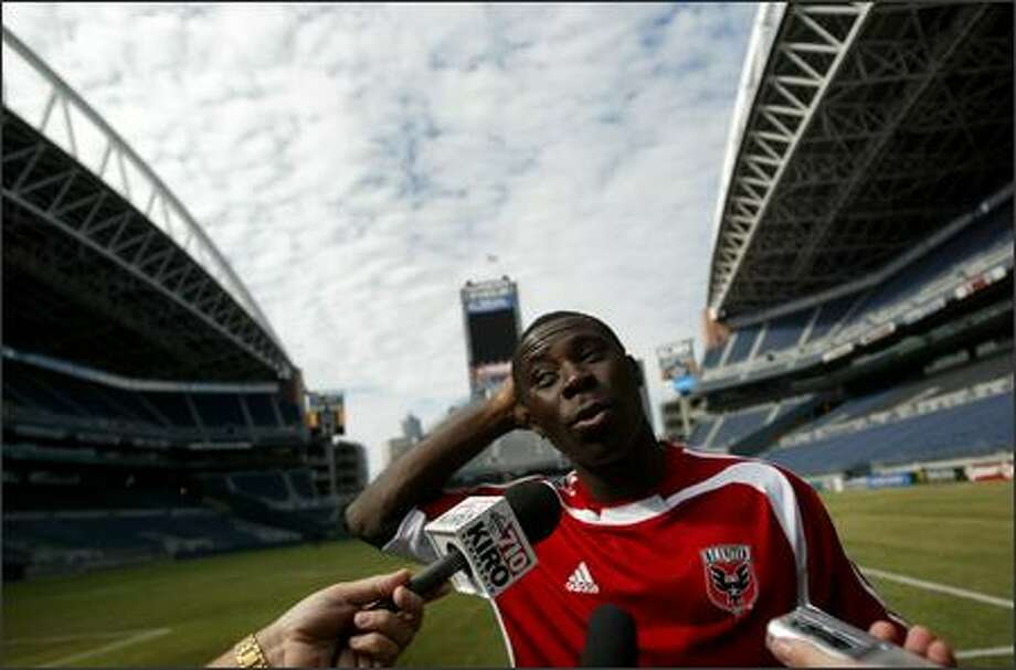 D.C. United and MLS star Freddy Adu talks with reporters after practice Tuesday at Qwest Field in Seattle. Adu and the D.C. United team took on Real Madrid and international superstar David Beckham Wednesday night. Final score: 1-1. Photo: Joshua Trujillo, Seattlepi.com / seattlepi.com