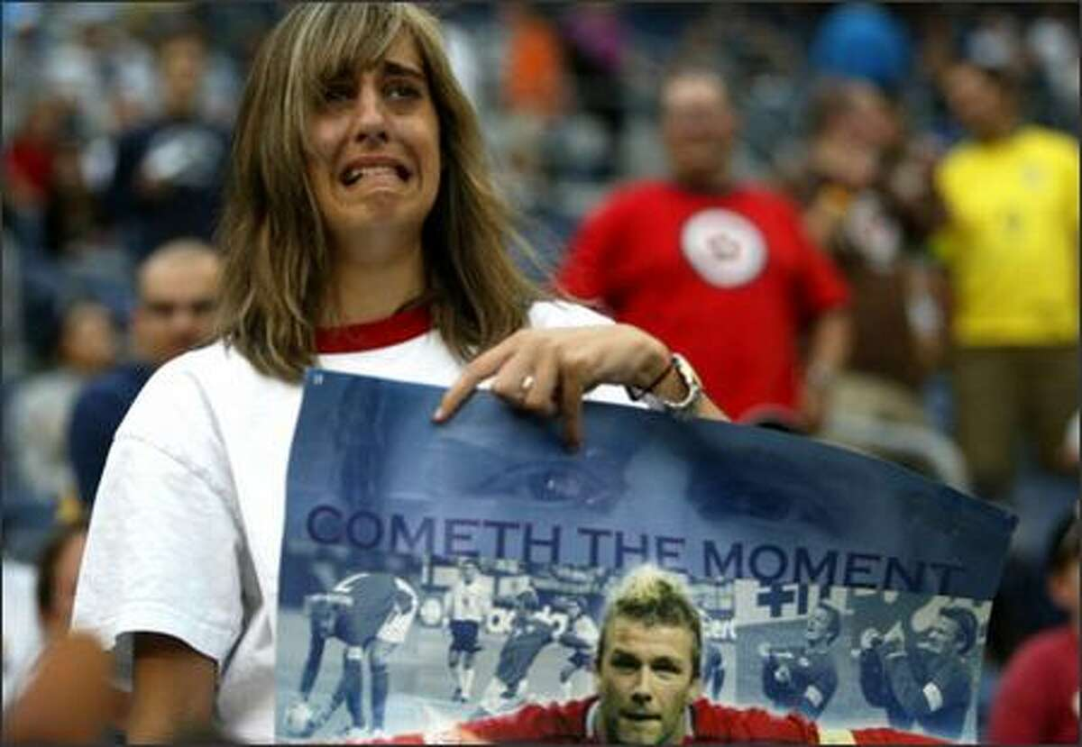Holly Rourke of British Columbia cries upon seeing soccer superstar David Beckham as his team, Real Madrid, enters Qwest Field on Wednesday to take on D.C. United. The friendly match was played in front of 60,000 fans.