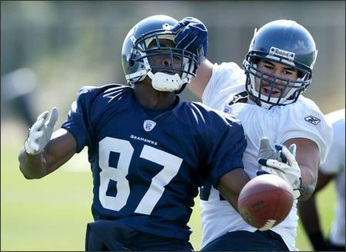 Seattle Seahawks middle linebacker Lofa Tatupu breaks up a pass intended for rookie receiver Ben Obomanu (87) on Thursday at training camp in Cheney.