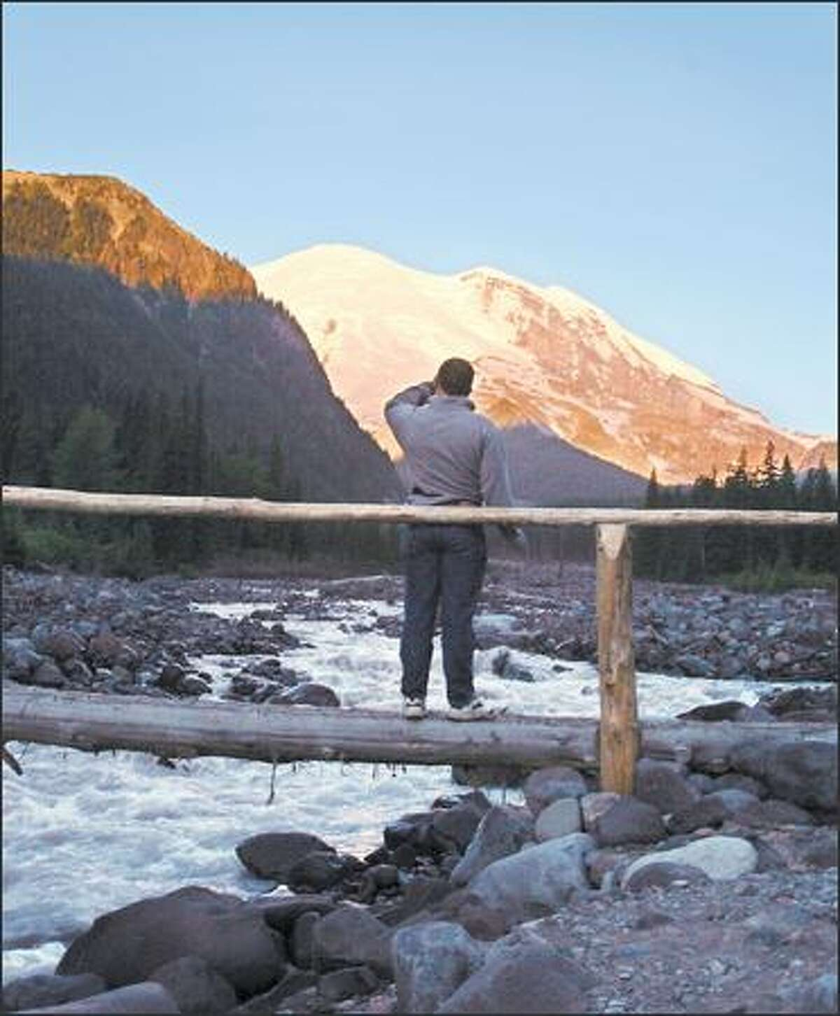 Mark Wetters of Sacramento watches the sunrise from the White River campground.