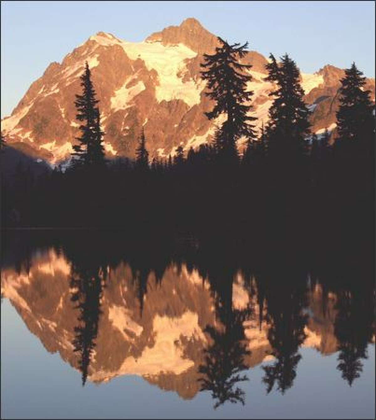 Mount Shuksan is reflected in the aptly named Picture Lake during a recent sunset.