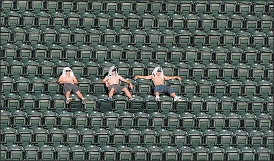 Safeco Field's upper deck has been sparsely populated the past two seasons, but the Seattle Mariners are still fourth in attendance in the American League. Photo: Meryl Schenker, Seattle Post-Intelligencer / Seattle Post-Intelligencer