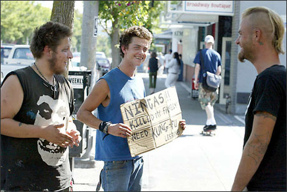 Panhandlers hang out in front of Dick's Drive-In on Broadway in Capitol Hill. They are allowed to stand, but not to sit, on the sidewalk. The city is trying to resuscitate Broadway with a sweeping set of changes to the area, including land-use changes and zoning adjustments. Photo: Meryl Schenker, Seattle Post-Intelligencer / Seattle Post-Intelligencer