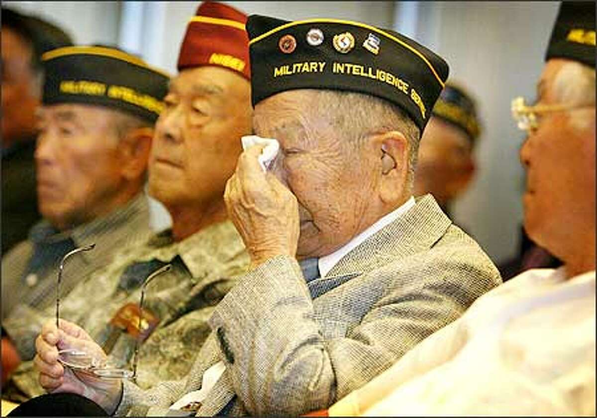 Yosh Iwamoto, 83, dries his eyes as he listens to the Seattle City Council read a proclamation Monday honoring the service of nisei veterans of World War II.