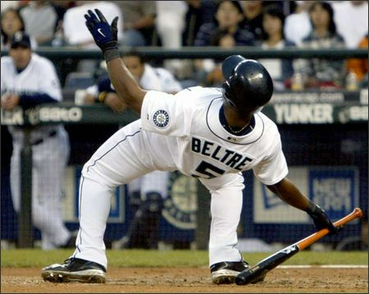 Mariners third baseman Adrian Beltre falls backward in his attempt to avoid being hit by a pitch in the third inning.