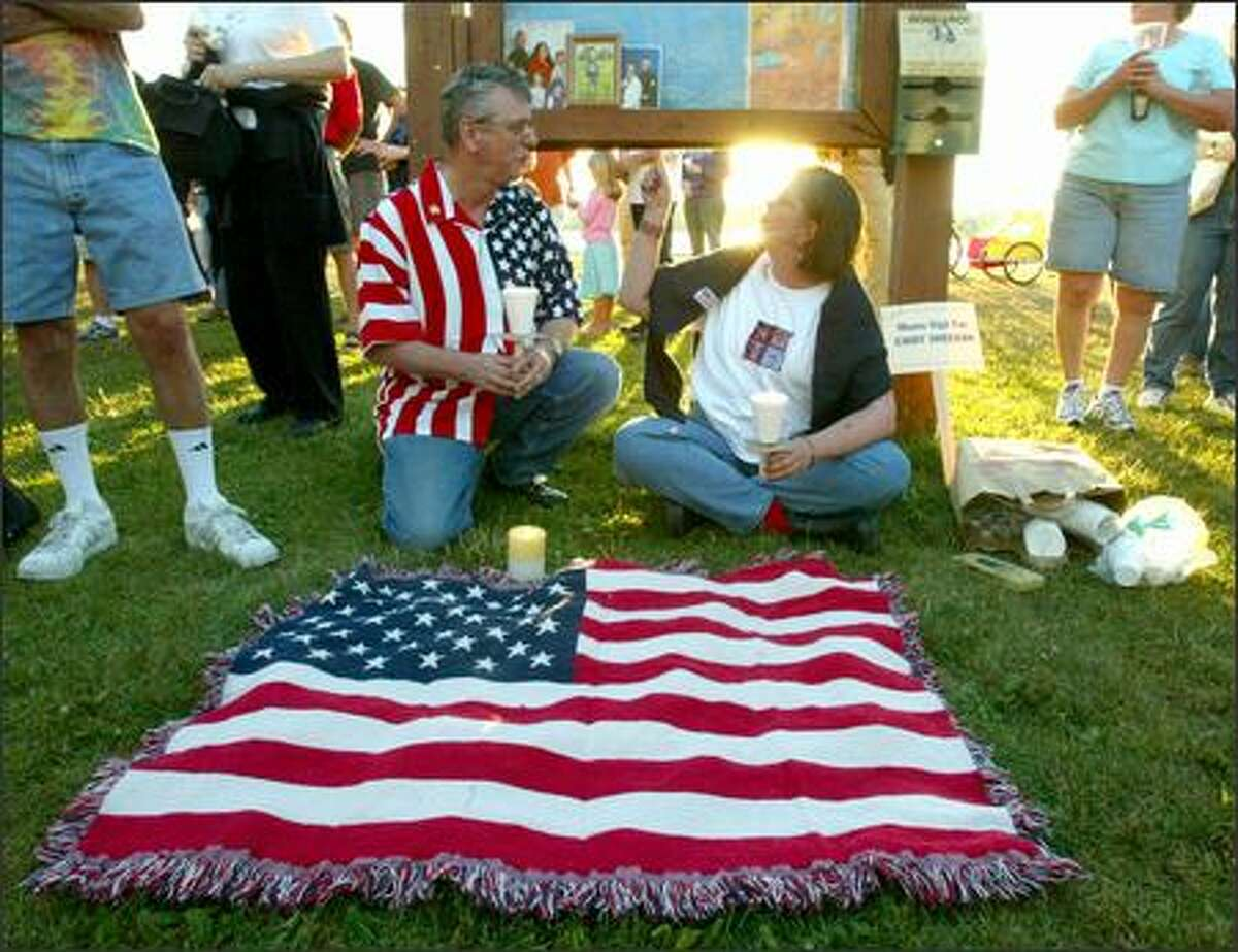 Bob and Valerie Kiesel set up a small display to their son, Tom, a Marine who has served one tour in the Middle East and is expecting to go again, at Green Lake Park.