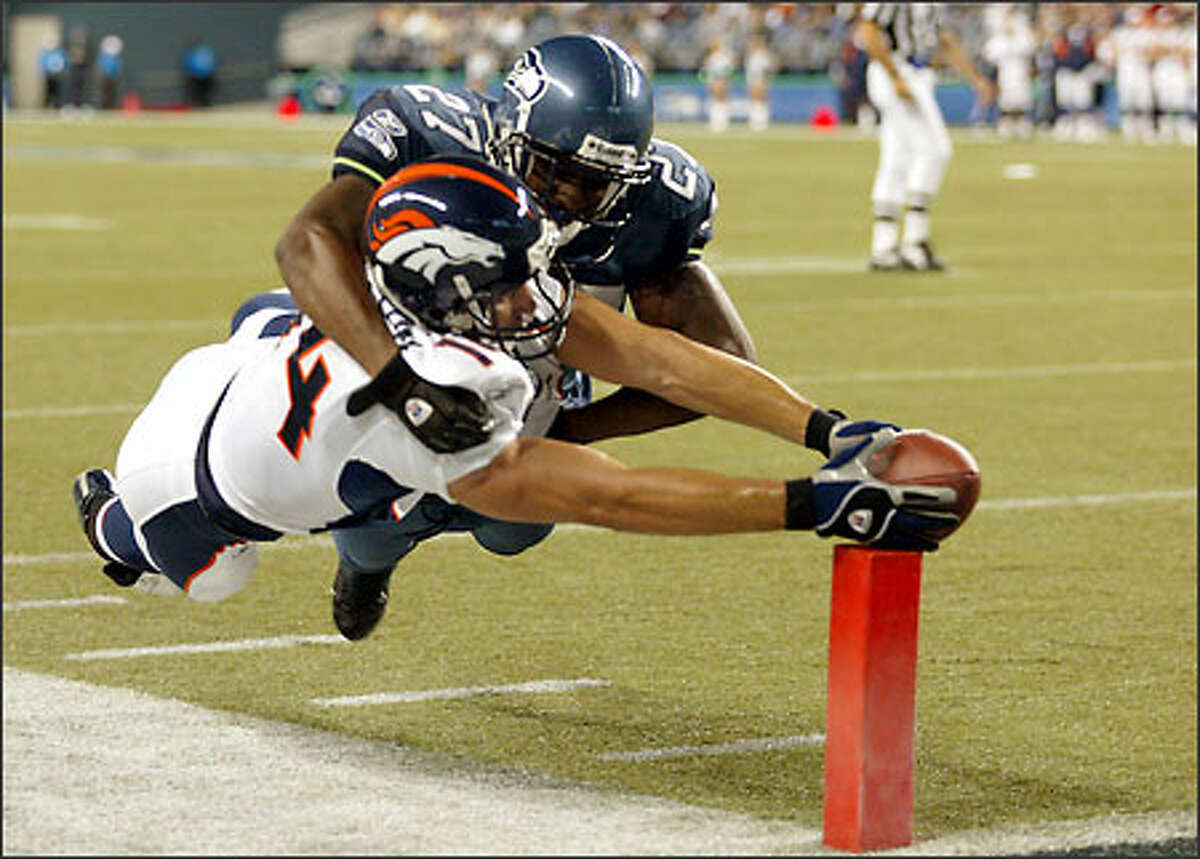 Seahawks strong safety Jordan Babineaux rides Broncos wide receiver Nate Jackson over the corner of the endzone during the fourth quarter. Jackson was called for offensive pass interference on the play.