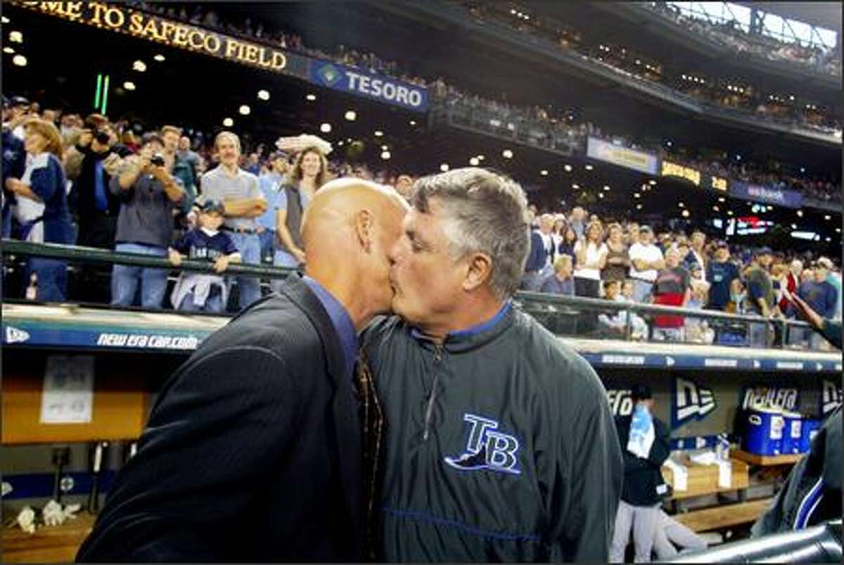 Lou Pinella and Jay Buhner kiss after the ceremony.
