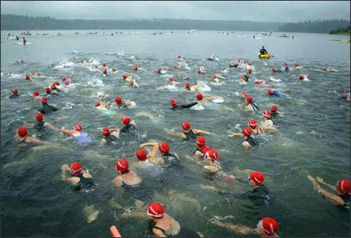 Danskin Women's Triathlon participants take the plunge into Lake Washington on Sunday, August 19, 2007 at Genesee Park in Seattle.