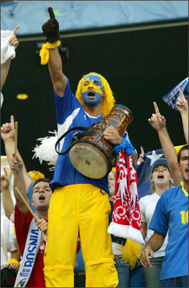 Samedin Duldanic cheers on Bosnia in the All Nations Cup final against Brazil at Seattle's Qwest Field. Fans came with drums, tambourines, cowbells and other noisemakers yesterday to cheer on teams. Photo: Grant M. Haller, Seattle Post-Intelligencer / Seattle Post-Intelligencer