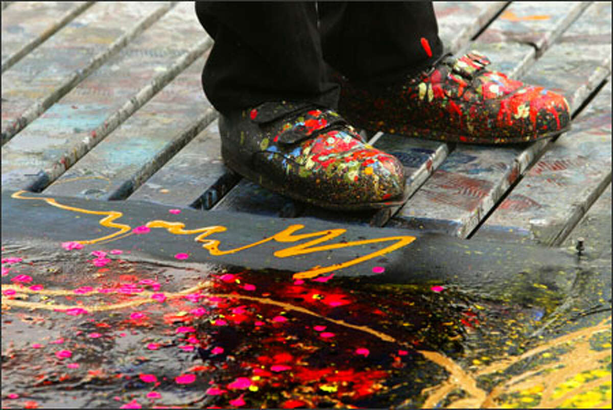 Glass artist Dale Chihuly's shoes, and the deck of his Lake Union studio, are splattered with the residue from tests of different color combinations for a glass installation he is designing for the Fairchild Tropical Gardens in Miami.