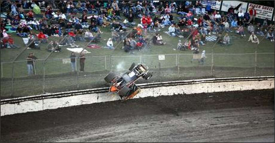 Tony Stewart flips in the first lap of the first heat race during the Kasey Kahne Foundation Benefit Race at the Skagit Speedway. Photo: Meryl Schenker, Seattle Post-Intelligencer / Seattle Post-Intelligencer